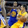 Los Angeles Lakers\' Steve Nash, right, looks to pass against Golden State Warriors defenders including Jarrett Jack (2) during the first half of a preseason NBA basketball game in Fresno, Calif., Sunday, Oct. 7, 2012. (AP Photo/Gary Kazanjian)
