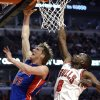Detroit Pistons forward Kyle Singler (25) shoots against Chicago Bulls forward Luol Deng during the first half of an NBA basketball game in Chicago, Sunday, March 31, 2013. (AP Photo/Nam Y. Huh)