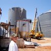 Sentinel Co-op manager Bill Grant surveys two massive grain bins that were destroyed by powerful straight winds during Thursday, June 5, 2008, night\'s storms. BY RON JACKSON, THE OKLAHOMAN