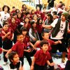 Photo - At selected schools, the Be Kind People Project holds high-energy school assemblies featuring performances by the Be Kind Crew, a group of energetic and gifted young performers that use classical technique, urban style, hip hop rhythms and slam poetry to communicate the organization's kindness messages. Shown here at a Los Angeles school assembly (left to right): Vo Vera, Codi Starner and Vincent Calleros from The Be Kind Crew. Photo provided.