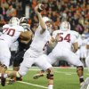 Photo - Stanford's Kevin Hogan throws against Oregon State during the first half of an NCAA college football game in Corvallis, Ore., Saturday Oct. 26, 2013. (AP Photo/Greg Wahl-Stephens)