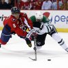 Photo - Washington Capitals right wing Alex Ovechkin (8), from Russia, tries to shoot as he is guarded by Dallas Stars defenseman Alex Goligoski (33) in the first period of an NHL hockey game, Tuesday, April 1, 2014, in Washington. (AP Photo/Alex Brandon)