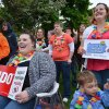 Photo - Katelyn Walls, seated, 25, of Parkersburg, W. Va., her sister Merideth Paff, standing, at right, 30, of Erie, Pa., and Paff's son 3-year-old Nicholas Paff, seated, at right, attend a rally at Perry Square in Erie, Pa., on Tuesday, May 20, 2014, in support of marriage equality in Pennsylvania. About 150 people turned out to celebrate a federal judge's overturning of Pennsylvania's ban on gay marriage.  (AP Photo/Erie Times-News, Christopher Millette) MAGAZINES OUT.