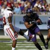 TCU\'s Sam Carter (17) comes down with an interception on a pass intended for Oklahoma\'s Justin Brown (19) in the first half of an NCAA college football game Saturday, Dec. 1, 2012, in Fort Worth, Texas. (AP Photo/Tony Gutierrez)