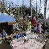 A family sets up a temporary shelter along a highway following Tuesday\'s devastating typhoon in Montevista township, Compostela Valley in the southern Philippines, Thursday, Dec. 6, 2012. The powerful typhoon that washed away emergency shelters, a military camp and possibly entire families in the southern Philippines has killed hundreds of people with nearly 400 missing, authorities said Thursday. (AP Photo/Bullit Marquez)