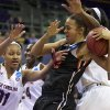 Photo - Oregon State forward Deven Hunter (32) is fouled as South Carolina's Asia Dozier (31) goes for the ball during the first half of a second-round game of the NCAA women's college basketball tournament, Tuesday, March 25, 2014, in Seattle. (AP Photo/The Oregonian, Randy L Rasmussen) MAGS OUT, TV OUT, LOCAL TV AND INTERNET OUT, (THE MERCURY, WILLAMETTE WEEK, PAMPLIN MEDIA GROUP OUT)