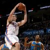 Oklahoma City\'s Nick Collison (4) grabs a rebound over New Orleans\' Willie Green (33) during the NBA basketball game between the Oklahoma City Thunder and the New Orleans Hornets, Wednesday, Feb. 2, 2011 at the Oklahoma City Arena. Photo by Bryan Terry, The Oklahoman