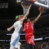 Photo - Houston Rockets guard Jeremy Lin, right, goes up for shot as Denver Nuggets center Timofey Mozgov, of Russia, covers in the first quarter of an NBA basketball game in Denver on Wednesday, April 9, 2014. (AP Photo/David Zalubowski)