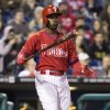 Photo - Philadelphia Phillies' Jimmy Rollins reacts to a swinging strike during the fourth inning of an exhibition baseball game against the Pittsburgh Pirates, Friday, March 28, 2014, in Philadelphia. Rlollins popped out on the at-bat. (AP Photo/Chris Szagola)