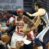 Chicago Bulls guard Richard Hamilton, left, drives against Memphis Grizzlies center Marc Gasol, of Spain, and Tony Allen during the first half of an NBA basketball game in Chicago on Saturday, Jan. 19, 2013. (AP Photo/Nam Y. Huh)