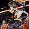 Photo - Miami Heat's Udonis Haslem (40) dunks in front of Chicago Bulls' Joakim Noah (13) during the first half of Game 5 of an NBA basketball Eastern Conference semifinal, Wednesday, May 15, 2013, in Miami. (AP Photo/Wilfredo Lee)