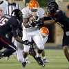 Oklahoma State \'s Rennie Childs (23) runs through Texas Tech\'s Keenon Ward (15) and Justis Nelson (31) during the college football game between the Oklahoma State University Cowboys (OSU) and the Texas Tech University Red Raiders (TTU) at Jones AT&T Stadium in Lubbock, Tex. on Saturday, Nov. 2, 2013. Photo by Chris Landsberger, The Oklahoman
