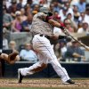 Photo - San Diego Padres' Everth Cabrera connects on a hard line drive that was caught in right field but allowed a run to score from third against the Atlanta Braves in the fourth inning of a baseball game Sunday, Aug. 3, 2014, in San Diego.  (AP Photo/Lenny Ignelzi)