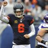 Photo - Chicago Bears quarterback Jay Cutler (6) pumps his fist after throwing a touchdown pass to tight end Martellus Bennett during the first half of an NFL football game against the Minnesota Vikings, Sunday, Sept. 15, 2013, in Chicago. (AP Photo/Jim Prisching)