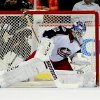 Photo - Columbus Blue Jackets goalie Sergei Bobrovsky (72), of Russia, deflects the puck during the first period of an NHL hockey game against the Anaheim Ducks, Monday, Feb. 3, 2014, in Anaheim, Calif. (AP Photo/Gus Ruelas)