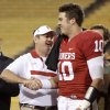Oklahoma coach Bob Stoops shakes hands with Oklahoma\'s Blake Bell (10) after Bell was named the offensive player of the game following Oklahom\'s win in the Insight Bowl college football game between the University of Oklahoma (OU) Sooners and the Iowa Hawkeyes at Sun Devil Stadium in Tempe, Ariz., Friday, Dec. 30, 2011. Photo by Bryan Terry, The Oklahoman