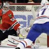 Photo - Chicago Blackhawks goalie Corey Crawford (50) blocks a shot by Montreal Canadiens' Max Pacioretty (67) during the first period of an NHL hockey game in Chicago, Wednesday, April 9, 2014. (AP Photo/Nam Y. Huh)