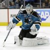 San Jose Sharks goalie Antti Niemi, of Finland, stops a shot on goal against the Phoenix Coyotes during the second period of an NHL hockey game in San Jose, Calif., Saturday, Feb. 9, 2013. (AP Photo/Marcio Jose Sanchez)