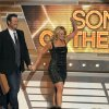 Miranda Lambert, right, and Blake Shelton walk on stage to accept the award for song of the year for