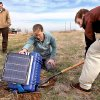 Graduate student Gabriel Mattei digs beneath a box held up by Katie Keranen, an assistant professor at the OU School of Geology and Geophysics, as the two place a seismometer and this recording device into the ground on the property of Joseph and Mary Reneau Saturday afternoon, Nov. 5. , 2011. The pair are accompanied by Austin Holland, left, a research seismologist with the Oklahoma Geological Survey. They are placing the devices on the Reneau property after an earthquake rattled the area in the area in the early morning hours Saturday. The Reneaus were awakened around 2:15 a.m. when their house shook and items began falling off the walls and form shelves and cabinets inside their two-story brick ranch-style home in rural Lincoln County, about six miles northwest of Prague. Holland placed the quake\'s epicenter within two to three miles of the Reneau home. Photo by Jim Beckel, The Oklahoman ORG XMIT: KOD