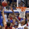 Photo - Iowa State forward Georges Niang, left, shoots over Kansas forward Jamari Traylor during the first half of an NCAA college basketball game in Lawrence, Kan., Wednesday, Jan. 29, 2014. (AP Photo/Orlin Wagner)