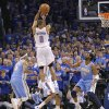 Oklahoma City\'s Russell Westbrook (0) puts up the shot that put the Thunder up for good over Denver during the first round NBA playoff game between the Oklahoma City Thunder and the Denver Nuggets on Sunday, April 17, 2011, in Oklahoma City, Okla. Photo by Chris Landsberger, The Oklahoman