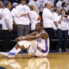 Oklahoma City\'s Kevin Durant (35) sits on the court while Russell Westbrook (0) shoots a free throw shot late in the fourth quarter during Game 5 of the Western Conference semifinals in the NBA playoffs between the Oklahoma City Thunder and the Los Angeles Clippers at Chesapeake Energy Arena in Oklahoma City, Tuesday, May 13, 2014. PHOTO BY SARAH PHIPPS, The Oklahoman