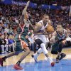 Oklahoma City\'s Russell Westbrook (0) drives between Milwaukee \'s Brandon Jennings (3) and Milwaukee \'s Monta Ellis (11) during the season finally NBA basketball game between the Oklahoma City Thunder and the Milwaukee Bucks at Chesapeake Energy Arena on Wednesday, April 17, 2013, in Oklahoma City, Okla. Photo by Chris Landsberger, The Oklahoman
