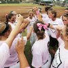 Edmond Santa Fe head coach Rhonda Lawson, upper right, gathers her team between innings during the high school softball game between Edmond Santa Fe and Putnam City North at Edmond Santa Fe High School in Edmond, Okla., Monday, September 13, 2010. Edmond Santa Fe wore pink shirts for cancer awareness. Photo by Nate Billings, The Oklahoman