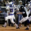 Photo - Millwood's Janari Glover outruns Meeker's Dylan Wolford on the way to his first half touchdown as the Millwood Falcons play the Meeker Bulldogs in state high school football playoffs on Friday, Nov. 29, 2013, in Meeker, Okla.  Photo by Steve Sisney, The Oklahoman