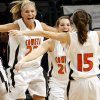 Coweta High School\'s Jordan Murphy (22), Ashley King (20) and Amy Sommer (15) celebrate the win over Carl Albert during the girls class 5A semifinals game at the Ford Center on Friday, March 7, 2008, in Oklahoma City, Okla. BY CHRIS LANDSBERGER, THE OKLAHOMAN