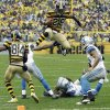 Pittsburgh Steelers running back Le\'Veon Bell (26) leaps for more yardage as he tries to evade Detroit Lions strong safety Glover Quin (27) and the defense in the first half of an NFL football game in Pittsburgh, Sunday, Nov. 17, 2013. (AP Photo/Gene J. Puskar)