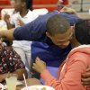 OKLAHOMA CITY THUNDER NBA BASKETBALL PLAYER / CHARITY: Oklahoma City\'s Russell Westbrook hugs Mary Thompson as Tywauna Douglas looks on during a Thanksgiving dinner at the Boys & Girls Club of Oklahoma County in Oklahoma CIty, Tuesday, Nov. 20, 2012. Photo by Sarah Phipps, The Oklahoman