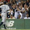 Photo - Fans react as New York Yankees' Alex Rodriguez (13) heads to the dug out after hitting a solo home run in the sixth inning of a baseball game against the Boston Red Sox, Sunday, Aug. 18, 2013, in Boston. (AP Photo/Michael Dwyer)
