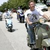 Photo - Brent Luke, of Oklahoma City, rides in the first Scoot for Conservation that ended at the Oklahoma City Zoo. PHOTOS BY JOHN CLANTON, THE OKLAHOMAN