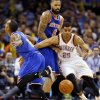 Oklahoma City\'s Thabo Sefolosha (25) steals the ball from New York\'s J.R. Smith (8) in front of Tyson Chandler (6) during an NBA basketball game between the New York Knicks and the Oklahoma City Thunder at Chesapeake Energy Arena in Oklahoma City, Sunday, Feb. 9, 2014. Photo by Nate Billings, The Oklahoman