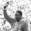 FILE - In an Oct. 15, 1964, file photo, United States\' Bob Hayes waves to the crowd from the victory stand after winning the men\'s 100-meter dash finals at the 1964 Tokyo Summer Olympics. Hayes\' gold medal in the 100 meters earned him the designation of the world\'s fastest human and provided him the opportunity to become the first Olympic champion to make it big in professional football as a wide receiver for nine years with the Dallas Cowboys, and a two-time All-Pro. With the 2012 London Summer Olympics over, The Associated Press takes a look at six teams that could look to copy Hayes\' success by pursuing Jamaican runner Usain Bolt. (AP Photo, File)