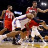 Oklahoma City\'s Russell Westbrook passes the ball around New Jersey\'s Devin Harris, left, and Brook Lopez during the NBA basketball game between the Oklahoma City Thunder and the New Jersey Nets at the Oklahoma City Arena, Wednesday, Dec. 29, 2010. Photo by Bryan Terry, The Oklahoman