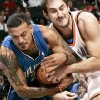 Photo - Oklahoma City's Nenad Krstic and Orlando's Matt Barnes battle for a loose ball during the Thunder's 102-74 win Sunday in the Ford Center.  PHOTO BY JOHN CLANTON, THE OKLAHOMAN