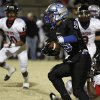 Guthrie\'s Kai Callins (9) is taken down by East Central\'s Michael Johnson (42) during a high school football game between Guthrie and East Central at The Rock in Guthrie, Friday, Nov. 18, 2011. Photo by Garett Fisbeck, The Oklahoman