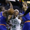 Boston Celtics forward Paul Pierce (34) drives between New York Knicks point guard Raymond Felton (2) and center Tyson Chandler (6) on his way to scoring a basket during the first half in Game 4 of a first-round NBA basketball playoff series in Boston, Sunday, April 28, 2013. (AP Photo/Elise Amendola)