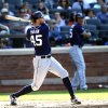 Photo - San Diego Padres'Jesse Hahn follows through on an RBI-single during the fourth inning of a baseball game against the New York Mets, Saturday, June 14, 2014, in New York. (AP Photo/Jason DeCrow)