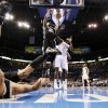 San Antonio\'s Tony Parker (9) watches from the ground as Tim Duncan (21) dunks a missed shot by Parker next to Oklahoma City\'s Royal Ivey (7) during the NBA basketball game between the Oklahoma City Thunder and the San Antonio Spurs at Chesapeake Energy Arena in Oklahoma City, Friday, March 16, 2012. Photo by Nate Billings, The Oklahoman