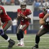 Tampa Bay Buccaneers quarterback Josh Freeman (5) passes against the Dallas Cowboys during the first half of an NFL football game on Sunday, Sept. 23, 2012, in Arlington, Texas. (AP Photo/Tony Gutierrez)