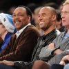 New York Yankees\' Derek Jeter, third from right, attends the New York Knicks against the Minnesota Timberwolves NBA basketball game with his father, Charles, third from left, on Sunday, Dec., 23, 2012, at Madison Square Garden in New York. (AP Photo/Kathy Kmonicek)
