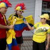 Photo - A young man holds a microphone up to fans decked out in the team colors of the Colombian national soccer team as they are interviewed by a television reporter in front of the hotel where the South American team is lodging in Fortaleza, Brazil, Thursday, July 3, 2014. Colombian supporters are in Fortaleza hoping to see some history being made in this northeastern World Cup city where Brazil and Colombia face off in the World Cup quarterfinals, Saturday. (AP Photo/Rodrigo Abd)