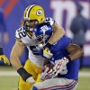 Green Bay Packers\' Clay Matthews (52) attempts to tackle New York Giants\' Victor Cruz during the first half of an NFL football game Sunday, Nov. 17, 2013, in East Rutherford, N.J. Cruz breaks the tackle on the play. AP Photo/Seth Wenig)
