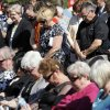 People pray during the 4/19 - 9/11 Survivor Tree dedication at Oklahoma Christian University.