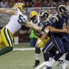 Photo - Green Bay Packers outside linebacker Clay Matthews, left, reaches for St. Louis Rams quarterback Sam Bradford during the second quarter of an NFL football game on Saturday, Aug. 17, 2013, in St. Louis. (AP Photo/Seth Perlman)