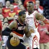 Photo - Portland Trail Blazers' LaMarcus Aldridge, left, pushes against Houston Rockets' Dwight Howard (12) in the second half of Game 5 of an opening-round NBA basketball playoff series Wednesday, April 30, 2014, in Houston. The Rockets won 108-98 to send the teams back to Portland for Game 6. (AP Photo/Pat Sullivan)
